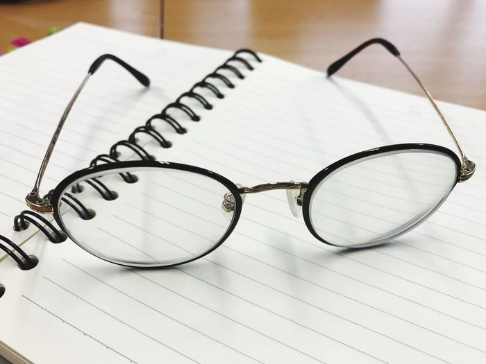 Close-up of eyeglasses on blank open book