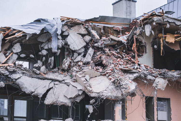 Low angle view of garbage on building