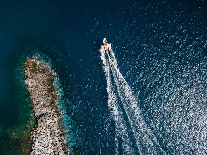 Sport Motion Nature Water Adventure People Sea Day High Angle View Transportation Aquatic Sport Full Length Speed Outdoors Travel on the move Nautical Vessel Leisure Activity