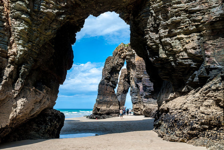 Natural rock arches Cathedrals beach (playa de las catedrales) Spain Atlantic ocean. Famous beach in Northern Spain. Natural rock arch on Cathedrals beach in low tide (Cantabric coast, Lugo (Galicia), Spain). Atlantic Atlantic Ocean Cathedrals Beach Galicia, Spain Playa De Las Catedrales Galicia Playa De Las Catedrales Praia Reflection Rock SPAIN Arches Beach Beauty In Nature Catedrales Day Island Nature No People Ocean Outdoors Scenics Sky Water Waterfront