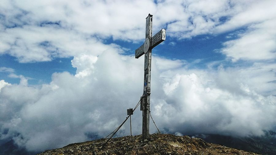 Low Angle View Of Cross On Land Against Sky