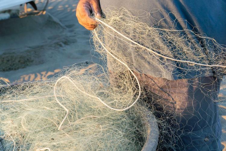 High angle view of fishing net on beach