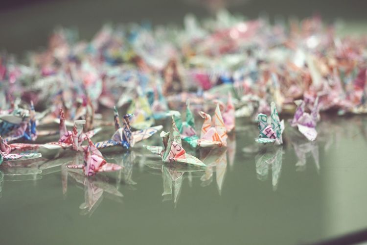 Close-up of origami birds on table