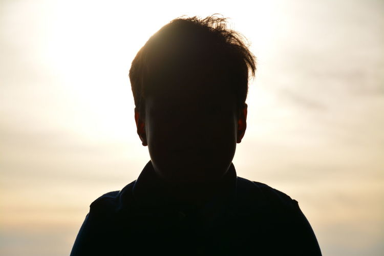 Close-Up Of Silhouette Boy Against Sky