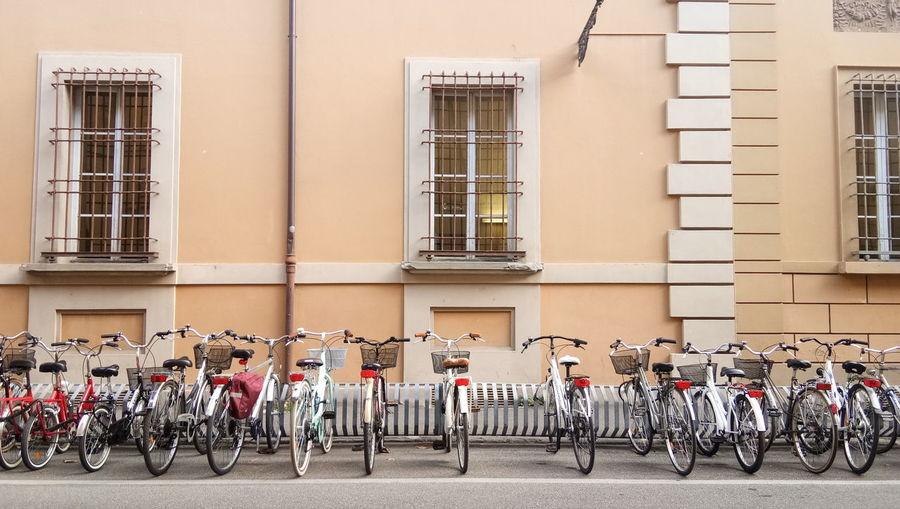 Bicycles parked on street against building