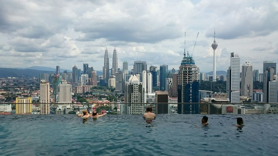 View from top Skyscraper City Architecture Urban Skyline Water Building Exterior Cloud - Sky Outdoors Modern City Life Built Structure Sky Cityscape Sport Downtown District Vacations Harbor People Day Swimming Pool Sea