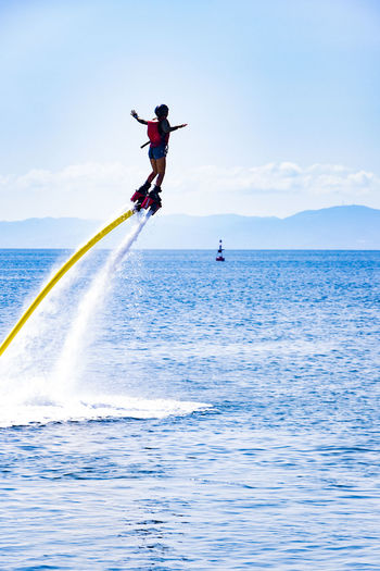 Adventure Balance Beauty In Nature Day Enjoyment Flyboard Flyboarding Full Length Fun Horizon Over Water Nature One Person Outdoors Real People Sea Sky Sport Water Waterfront Weekend Activities