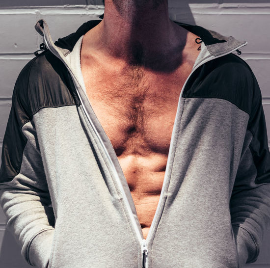 Abdominal Muscle Adult Beautiful People Casual Clothing Chest Clothing Fit Front View Fully Unbuttoned Hood - Clothing Indoors  Jacket Lifestyles Males  Masculinity Men Midsection Muscles Muscular Build One Person Posing Real People Shirtless Waist Up Young Men