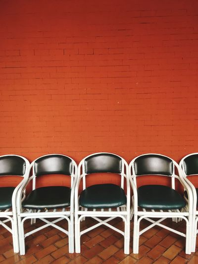 Chair Seat Empty Absence Indoors  Wall - Building Feature No People Wall Table Wood - Material Still Life Side By Side Flooring Brick Wall Brown Brick Red Relaxation In A Row Copy Space