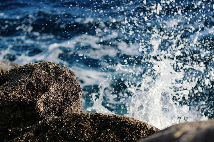 Close-up of waves splashing water