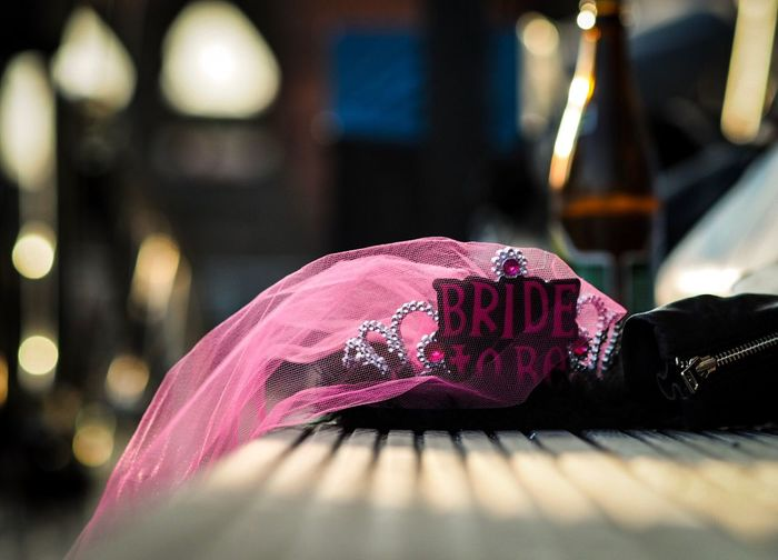 Text on crown with pink veil on table