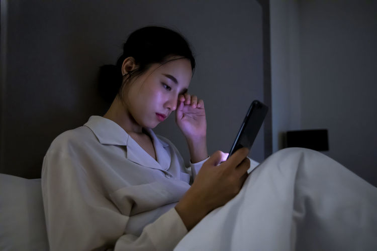 Midsection of woman using mobile phone