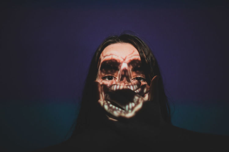 Digital composite image of spooky woman against blue background