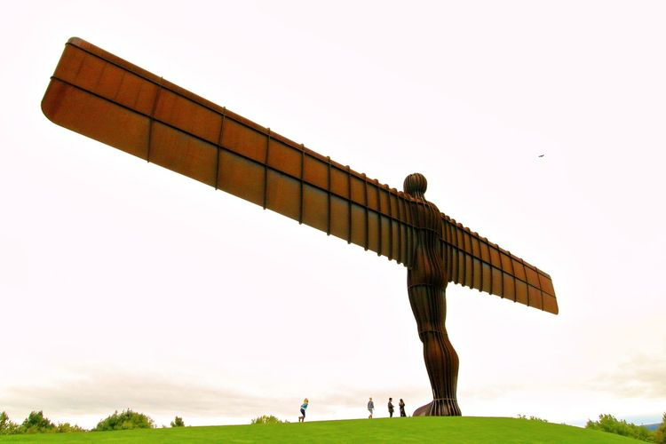 Angel Of The North Gateshead Adult Day Full Length Grass History Human Body Part Iron Statue Leisure Activity Low Angle View Monument Motion Nature One Person Outdoors Sky Sport Standing Travel Destinations Unrecognizable Person