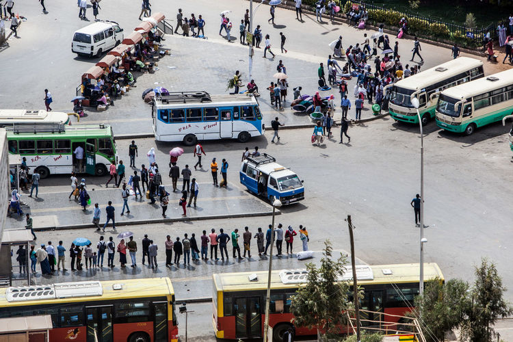 High angle view of people walking on road in city