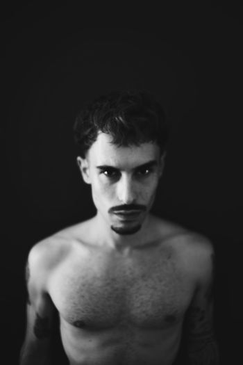Live fast. Die young. Be wild. OpenEdit EyeEm Best Edits Fashion The Week on EyeEm EyeEm Best Shots Portrait Looking At Camera One Person Shirtless Young Adult Black Background The Portraitist - 2018 EyeEm Awards Indoors  Beautiful People