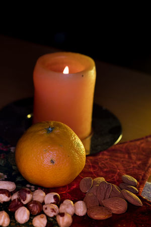 Winter Fruits With Candle Candle Cashew Nuts Nuts Almonds Burning Candle Candle Light Citrus Fruit Clementine Close Up Dark Background Day Flame Flash Photography Freshness Fruit Healthy Eating Illuminated Indoors  Indoors  No People Orange - Fruit Orange Color Patchwork Art