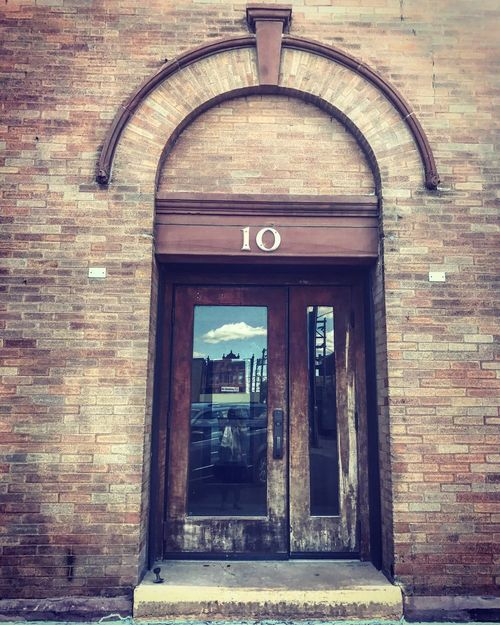 Doors with stories. Curved Architecture Number10 Architecture Door Building Exterior Built Structure No People Day Brick Wall Outdoors Downtown Fargo