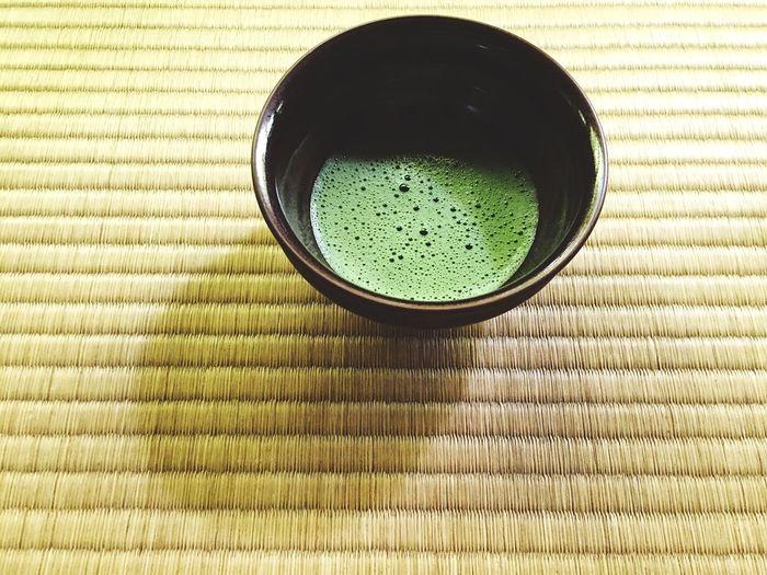 Close-Up Of Green Matcha Tea On Table