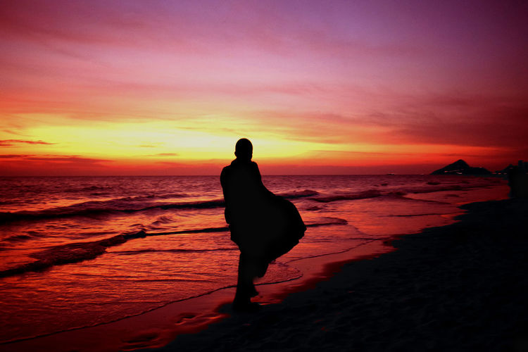 Monk work sunrise on the beach Sunset Sky Beach Sea Beauty In Nature Real People Water Silhouette Land Orange Color Leisure Activity Lifestyles Scenics - Nature Standing Cloud - Sky One Person Horizon Over Water Full Length Nature Outdoors Monk