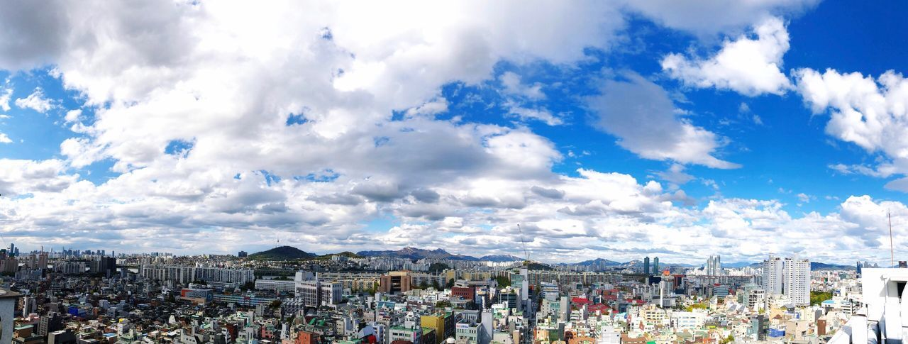 High angle view of townscape against cloudy sky