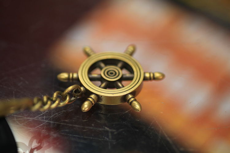 A keychain of a ships wheel Close-up Day Indoors  Manouver No People Old-fashioned Selective Focus Ship Ship Wheel Technology Vessel