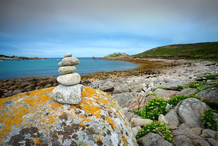Pebble pile on rock Beauty In Nature Cloud - Sky Day Land Lichen Nature No People Non-urban Scene Outdoors Pebble Pebble Pile Rock Rock - Object Rock Formation Scenics - Nature Sea Sky Solid Stone - Object Tranquil Scene Tranquility Water