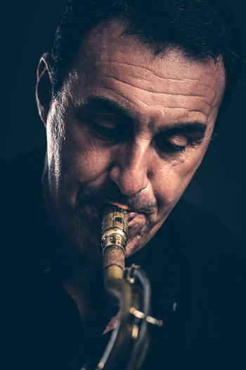 Saxophonist play music with his saxophone Blues Jazz Man Music Saxophonist Adult Adults Only Black Background Close-up Hobby Indoors  Instrument Jazz Music Men Musician One Man Only One Person People Playing Playing Instruments Saxophone