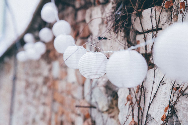 Close-Up Of White Lanterns On Wall