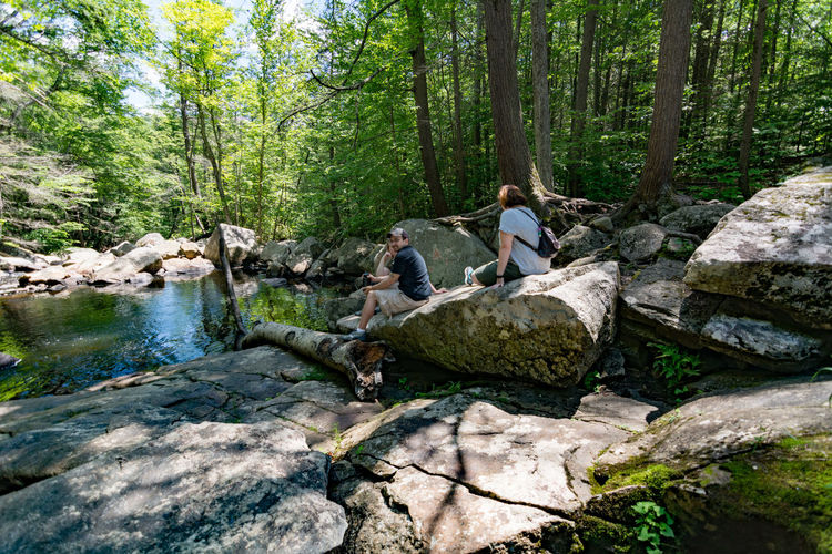 Adult Adults Only Adventure Backpack Casual Clothing Day Eco Tourism Forest Friendship Full Length Getting Away From It All Glendale Falls Heterosexual Couple Hiking Leisure Activity Mid Adult Middlefield, MA Nature Outdoors People River Rock - Object Togetherness Tree Vacations