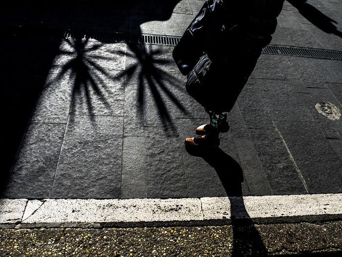 Low section of man on sidewalk