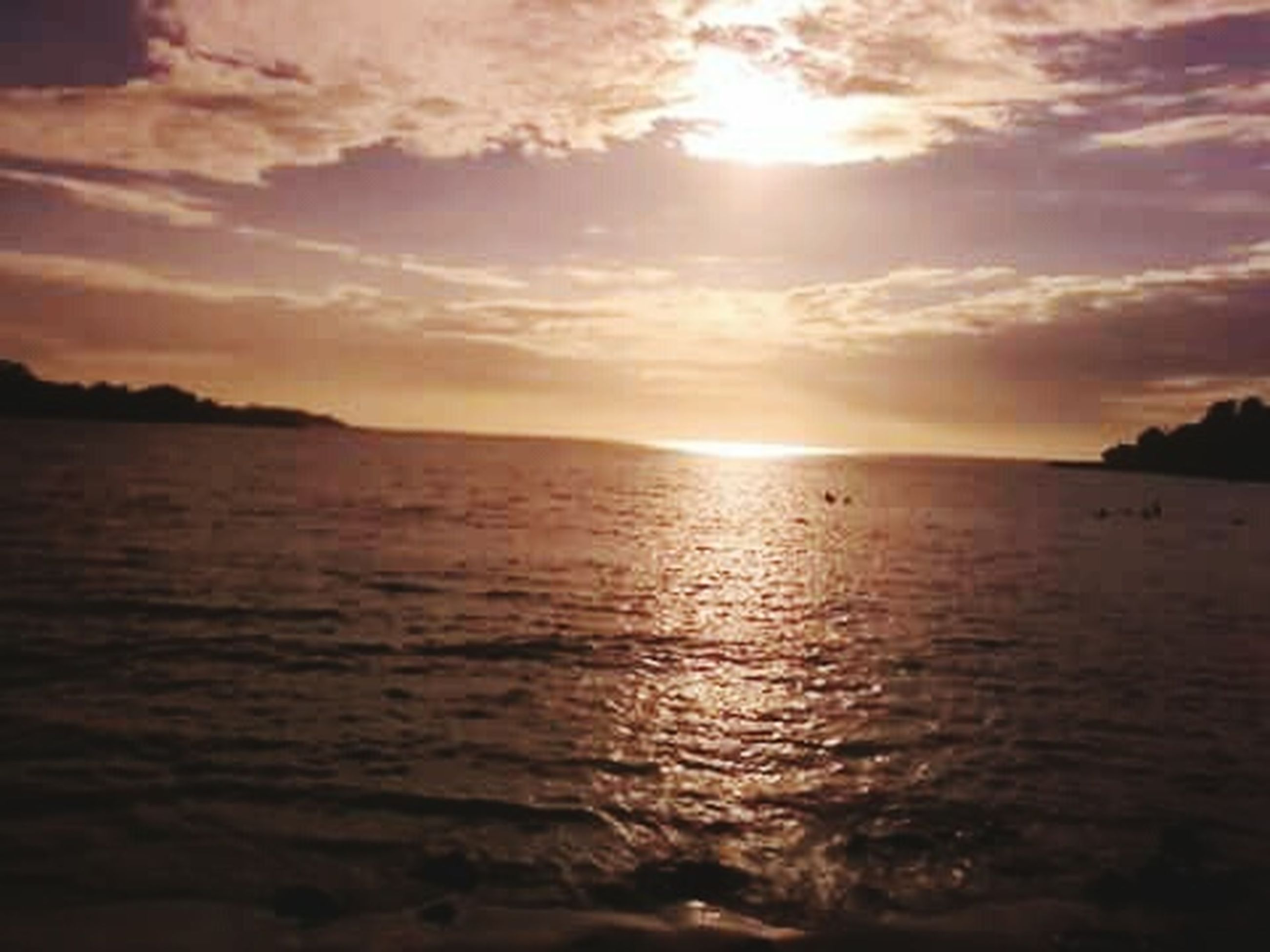 water, sunset, tranquil scene, scenics, sky, tranquility, beauty in nature, sea, sun, waterfront, reflection, cloud - sky, nature, idyllic, rippled, cloud, sunlight, silhouette, horizon over water, outdoors