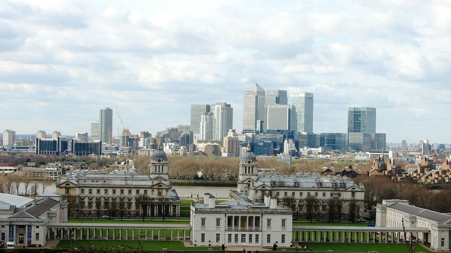 Royal Navy College By Cityscape Against Cloudy Sky