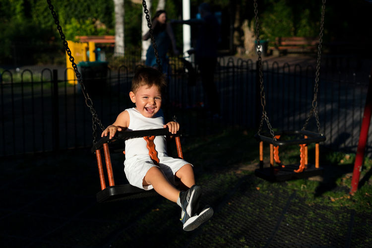 Baby boy in the playground Boys Child Childhood Full Length Innocence Leisure Activity Males  One Person Outdoors Playground Real People Sitting Swing Capture Tomorrow
