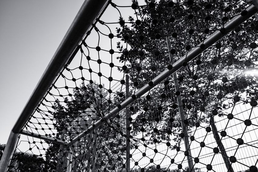 Goal Post Goal The Devil's In The Detail Summer In The City Street Photography Black & White Monochrome Urban Perspectives Urban Photography Tree Clear Sky Sky Close-up Built Structure Net - Sports Equipment Scoring A Goal Soccer Field