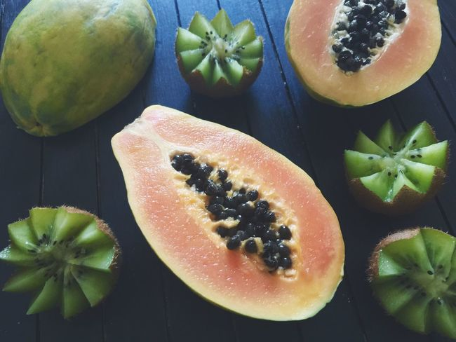 Fruit Healthy Eating Food And Drink Food SLICE Freshness Table No People Halved Indoors  Close-up Cross Section Papaya Kiwi - Fruit Day Papay