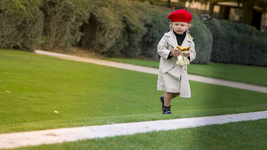 Bagle Beautiful Beauty In Nature Black Shoes Child Children Only Fashionable Front View Full Length Girls Grass Near Louvre Paris Green Color Green Vs Red Hello World Horizontal Louvre One Person Outdoors Paris Parisian Chic Portrait Red Hat Smiling Sport Woman Women Around The World Neighborhood Map