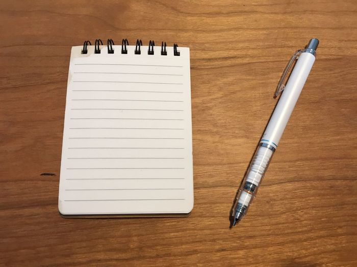 Close-up of pen and book on table