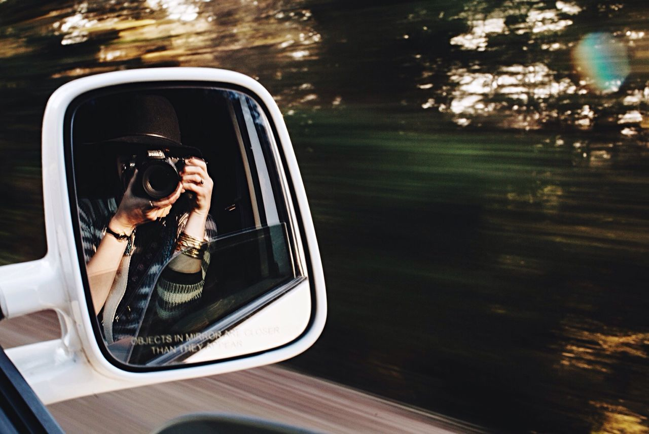 CROPPED IMAGE OF PERSON DRIVING CAR
