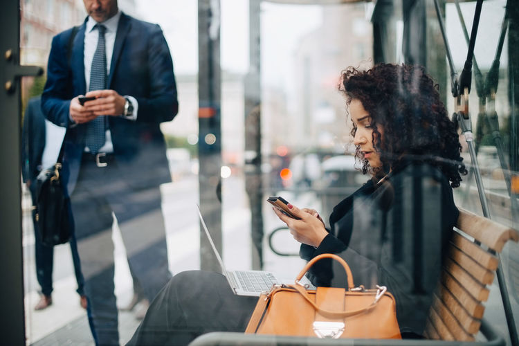 Woman holding mobile phone