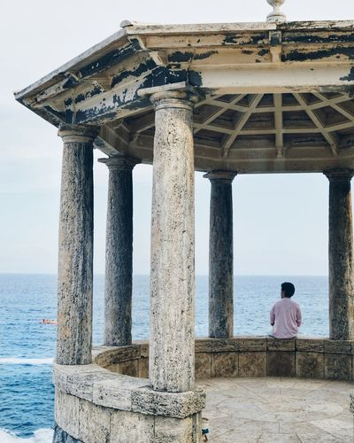 EyeEm Selects Architectural Column Architecture Built Structure Sea Beach Travel Destinations Day Water Sky Outdoors Adult People Nature One Man Only One Person Adults Only Lost In The Landscape