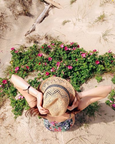 Relaxing on the beach Hat Flower One Person Plant Sun Hat Only Women One Woman Only Fashion High Angle View Women Outdoors Summer Swim Wear Sommergefühle