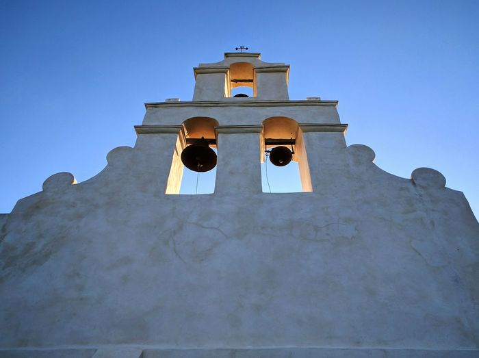 Low angle view of bell tower against clear sky