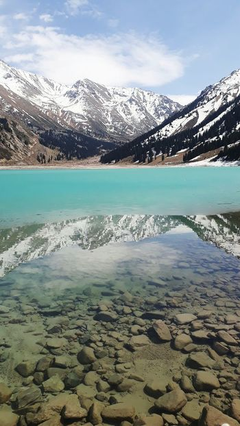big almaty lake in the mountains in kazachstan Reflection Clear Water Nature Landscape Ski Big Almaty Lake Kazakhstan Mountain Lake Turquoise Water Frozen Stones Water Mountain Lake Beach Sky Landscape Snow Covered Snowcapped Mountain Snow Winter Mountain Range Cold Snowcapped Frozen