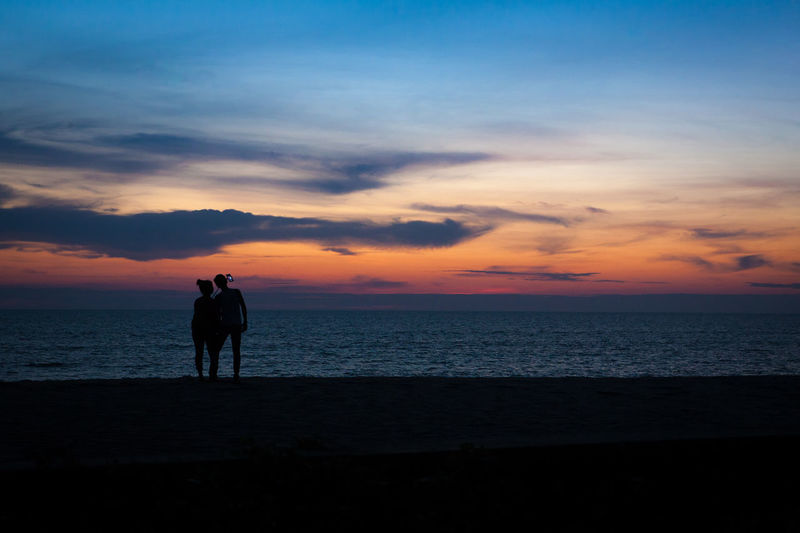 Love Silhouette Sunset Sea Two People Beach Cloud - Sky Rear View Adult Sky Full Length Scenics Only Men Adults Only Horizon Over Water Beauty In Nature People Togetherness Men Outdoors Standing Beauty In Nature Travel Destinations Landscape