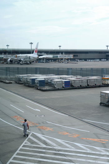 NARITAAIRPORT Narita International Airport Airplane Airport Cargo One Man Only One Person Outdoors Sky Transportation Walking