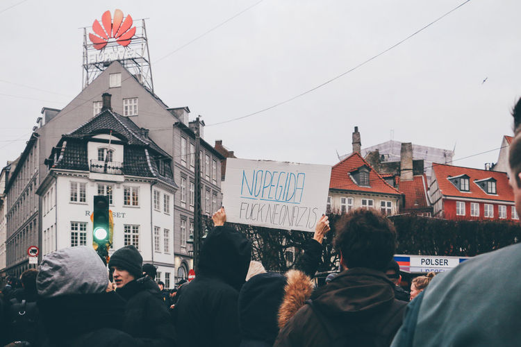 We experienced an anti-Neo Nazi protest on our first day in Copenhagen. Adult Adults Only Architecture Building Exterior Built Structure City Crowd Day Flag Large Group Of People Men Only Men Outdoors People Police Station Real People Sky Text Women First Eyeem Photo EyeEmNewHere EyeEmNewHere