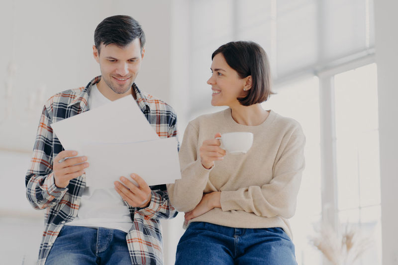 Young couple looking at paper