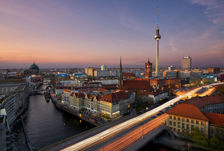 High Angle View Of Berlin City Lit Up At Sunset