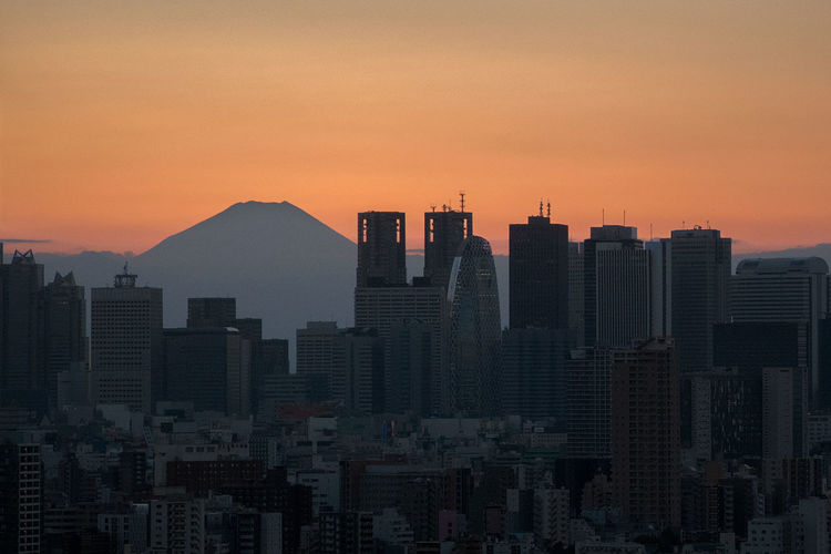 Shinjuku and the Fuji Mountain during orange sunset. Tokyo. Architecture Building Exterior Built Structure City Cityscape Fuji Fuji Mountain Fujiyama Japan Japan Photography Modern Mountain No People Orange Orange Sky Outdoors Sky Skyscraper Sunset Tokyo Travel Travel Destinations Travel Photography Urban Skyline The Architect - 2018 EyeEm Awards HUAWEI Photo Award: After Dark My Best Travel Photo